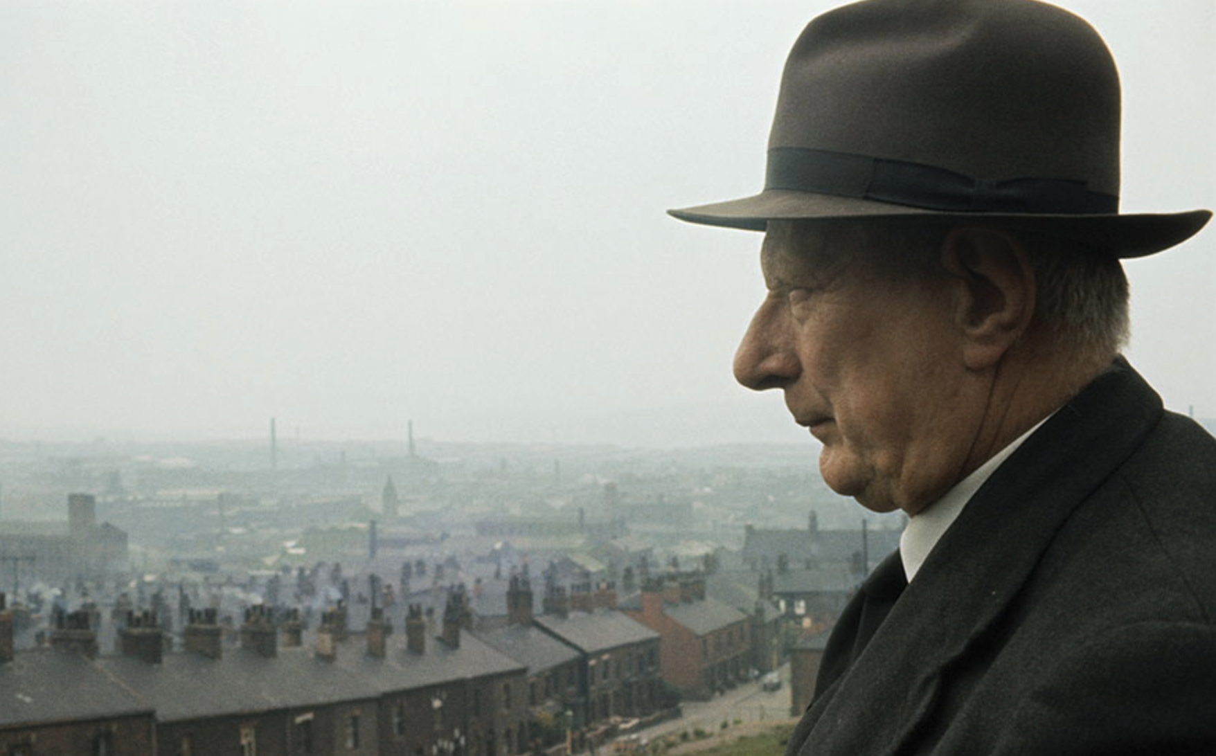 A photograph of Laurence Stephen Lowry with the industrial landscape of Pendlebury, Salford, England in the background (1964) by unknown.  (Laurence Stephen Lowry (1887 - 1976), English artist.)